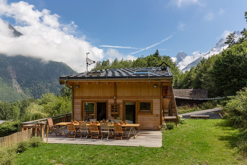 chalet in summer with 2 parking bays on the right