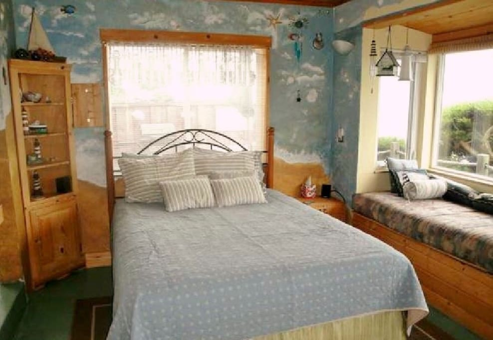 one queen sized bed, to the right is one of the window cushions (twin bed sized).