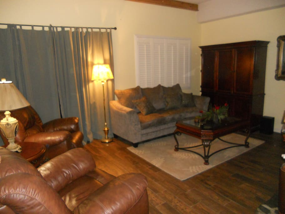 Large leather recliners and a very comfortable sofa/bed create a relaxing living room with spectacular views.