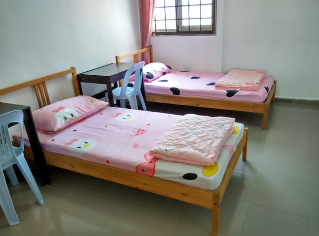 2 solid single beds each with a comfortable 6-inch spring mattress, a clean mattress protector, a clean bed sheet, a clean warm blanket and a clean comfortable pillow. Plus a big wardrobe, 2 desks and 2 chairs.