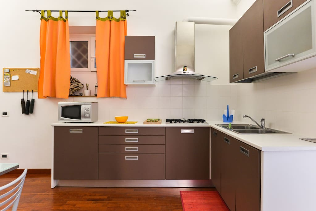 large kitchen with appliances