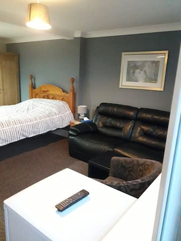 Room 2, kingsize and single bed, sofa and en suite