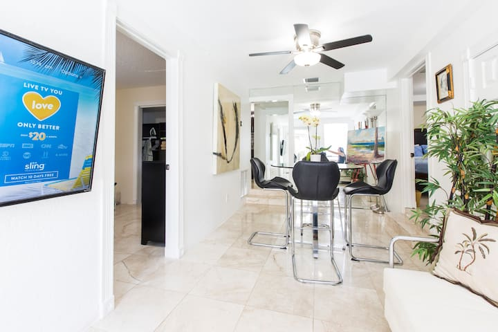 Beautifully decorated Living Room and Dining Room with 55 inch TV
