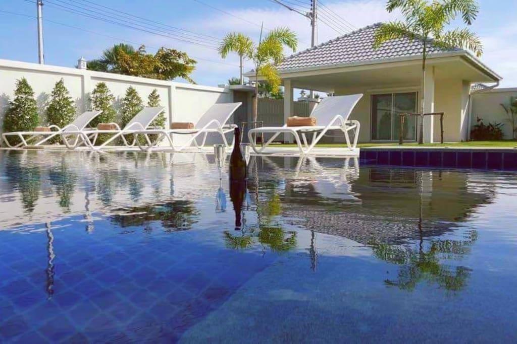 Huge pool with sundbed deck