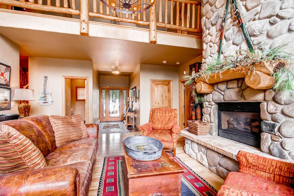 Sitting room - main floor. Complete with fireplace and family friendly games