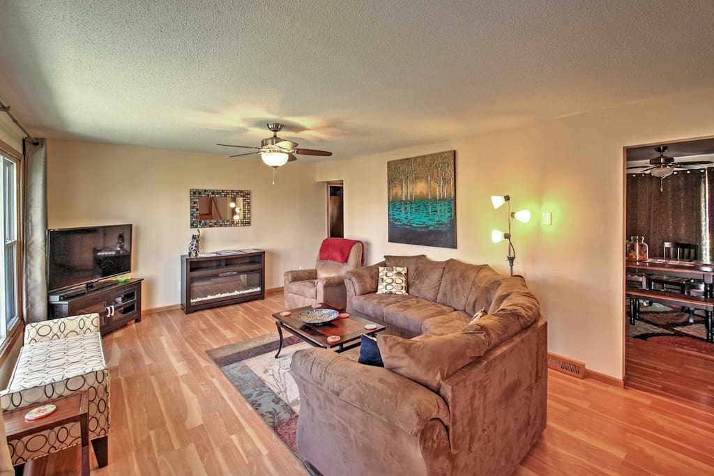 Relax in the living room and watch your favorite shows on the flat screen TV.