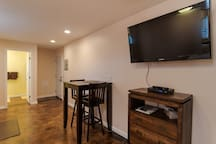 Flat screen TV, Dresser and table and chairs for two
