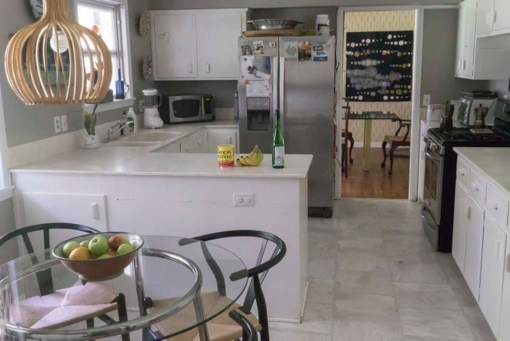 The well appointed kitchen is bright and  cheery. Includes a table that seats 4 people,  stainless appliances and a gas stove.