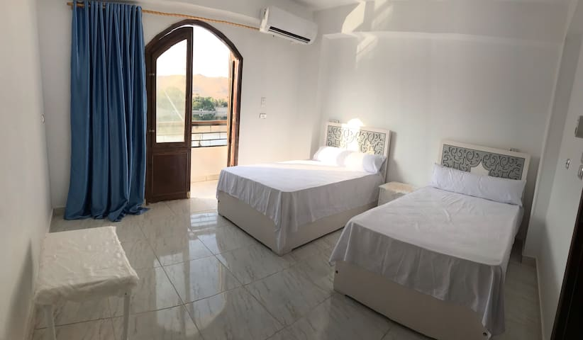 Bedroom and the balcony and show up the (kitchener's island) and the (nile view )and the (mountains )