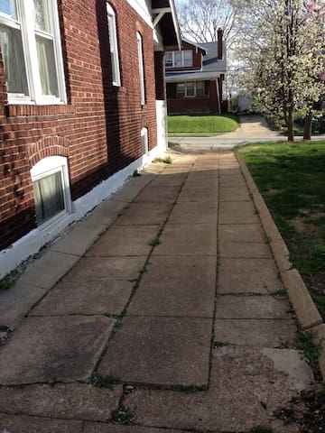 Driveway to parking in back