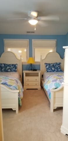 Charming children's room with two twin beds and TV.