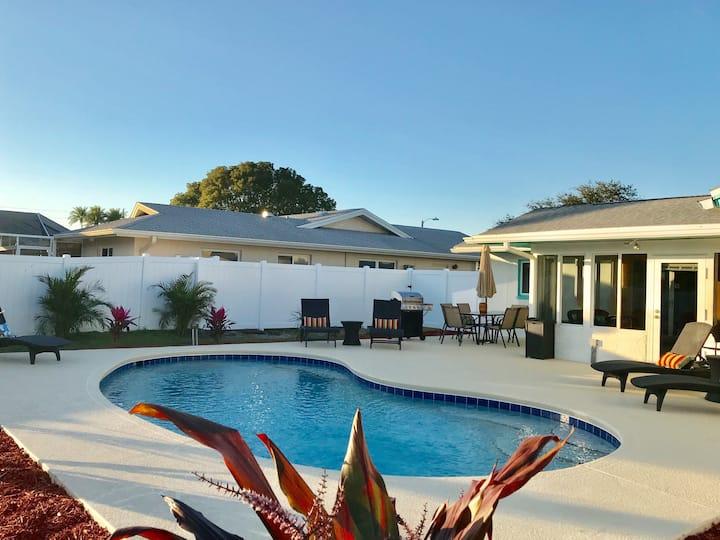 Sunshine Retreat with heated pool minutes to beach