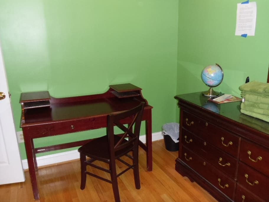 Room contains a large desk.