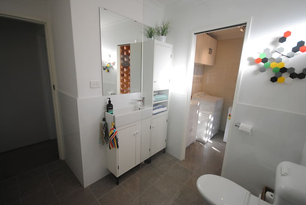 Fresh bathroom with direct laundry access