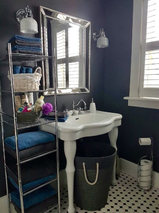 Lots of natural light in this quaint bathroom complete with claw tub and all the amenities.
