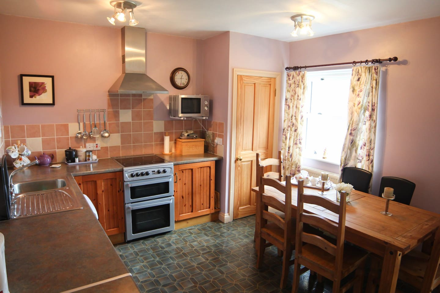 Fully Fitted kitchen In Lavender Cottage includes oven,microwave,slim line dishwasher with under work top fridge and separate freezer.