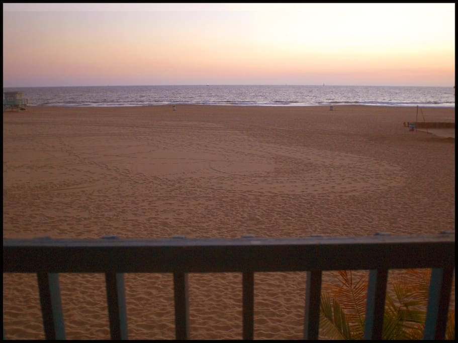 The view of the beach at sunset from your private balcony....