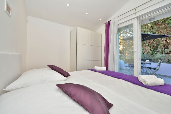 Large bedroom with terrace
