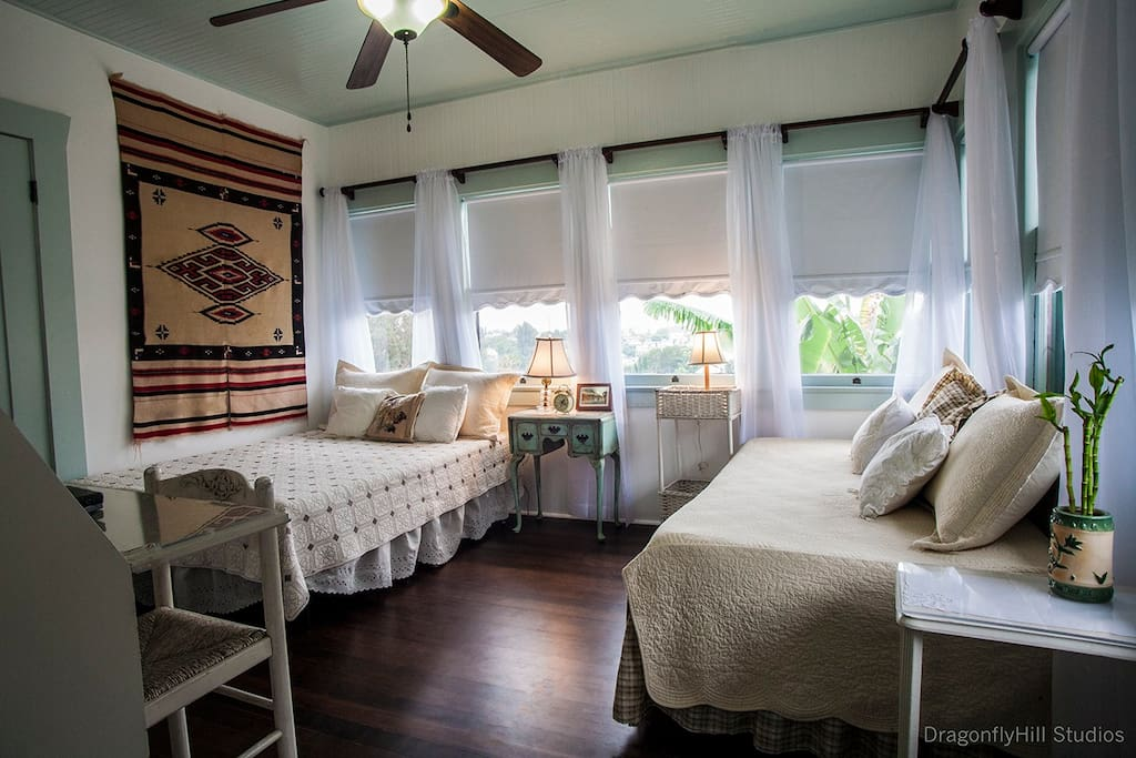 The second room is The Sleeping Porch which offers views of the Hollywood Hills, including the Hollywood Sign. It has 2 beds-- a twin and a full bed, and a secretary desk/dresser.