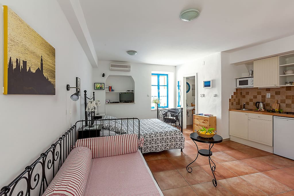 A spacious studio consists of integrated sleeping, lounge and dining area, kitchenette and separate bathroom.