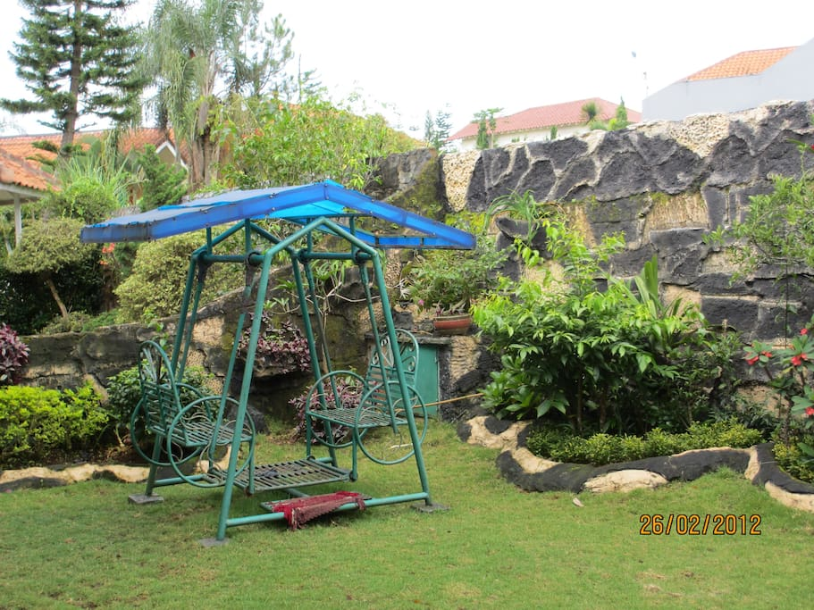 Garden behind the villa with swinging playground