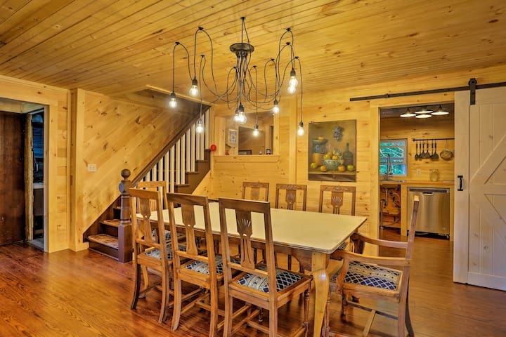 Inside, the wood-paneled home features accommodations for 7 guests.