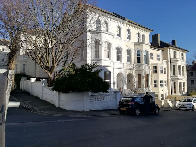View of the building and street in which the flat is located