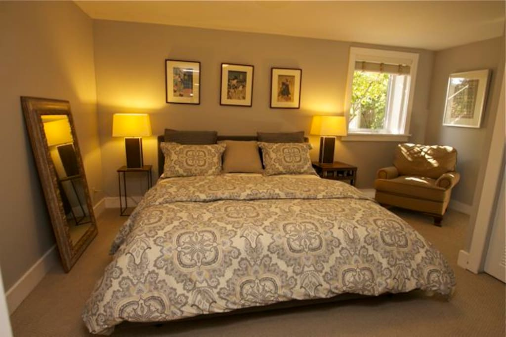 Luxury king bed with fine linens and furniture