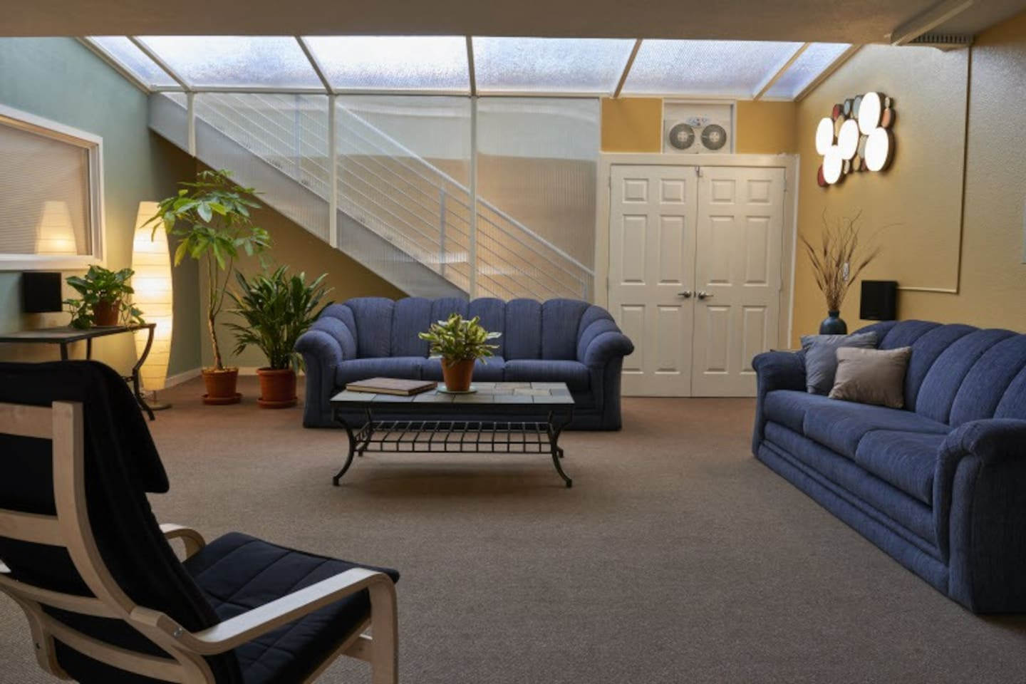 Large living room features a greenhouse ceiling and private entrance.