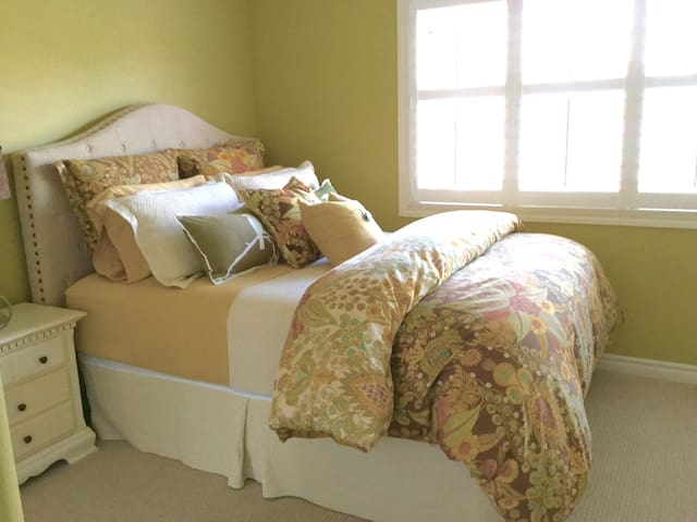 Beautiful bright clean bedroom with queen size bed