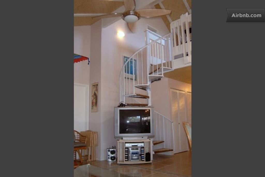 View of stairway to loft bedroom and bath