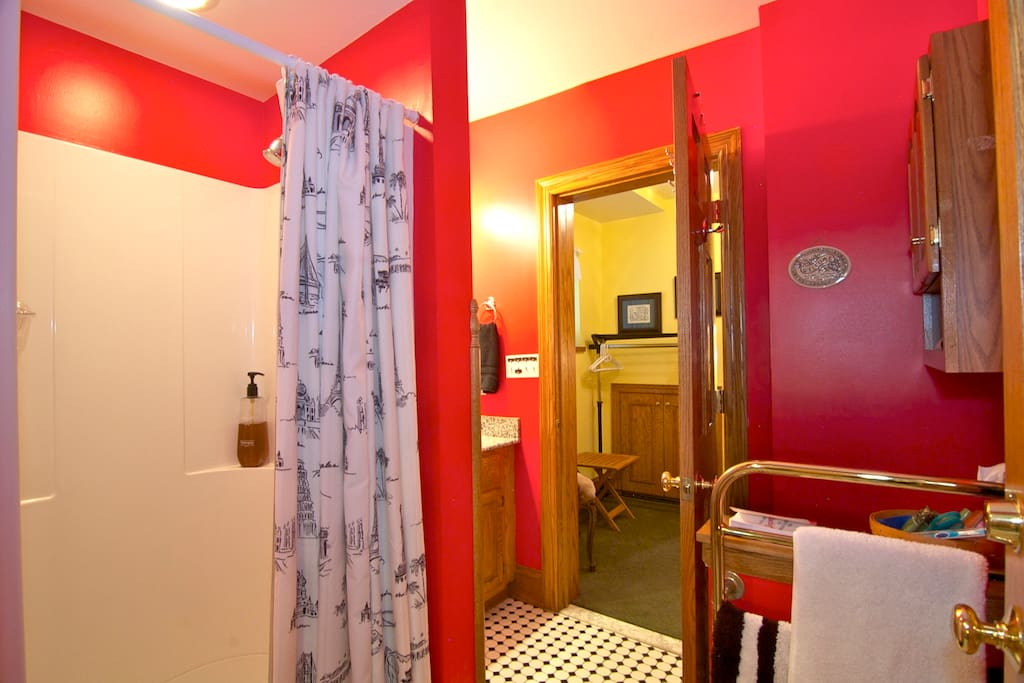 Shower, heated towel rack, granite counter sink, oak cabinet and medicine chest, commode, and radiant heated ceramic tile floor.