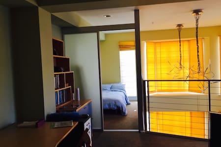Room w/ bath in sunny SOMA condo
