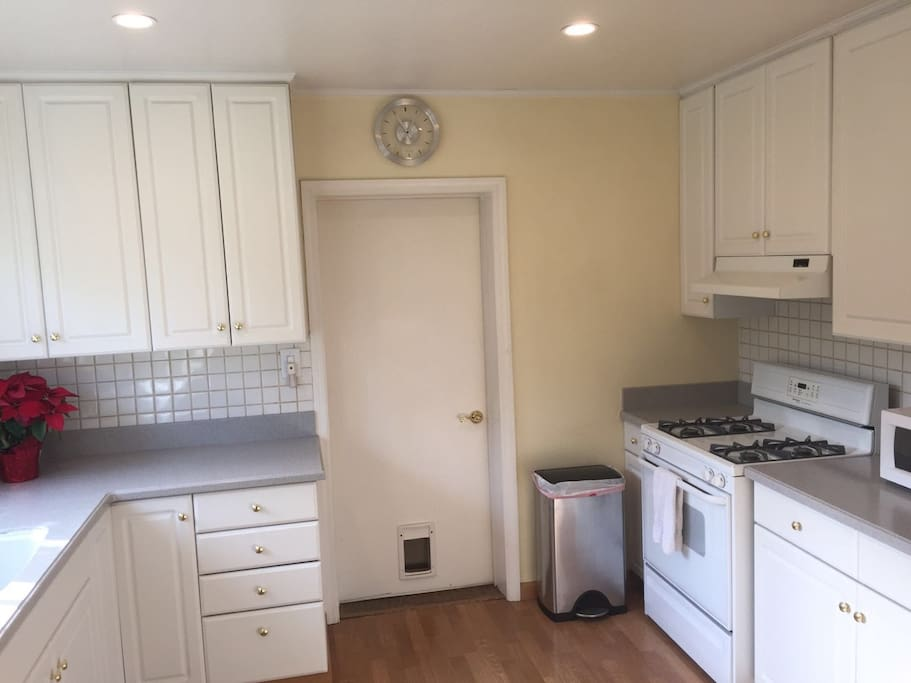 Spacious kitchen is perfect for home cooking. Lots of cabinet space.
