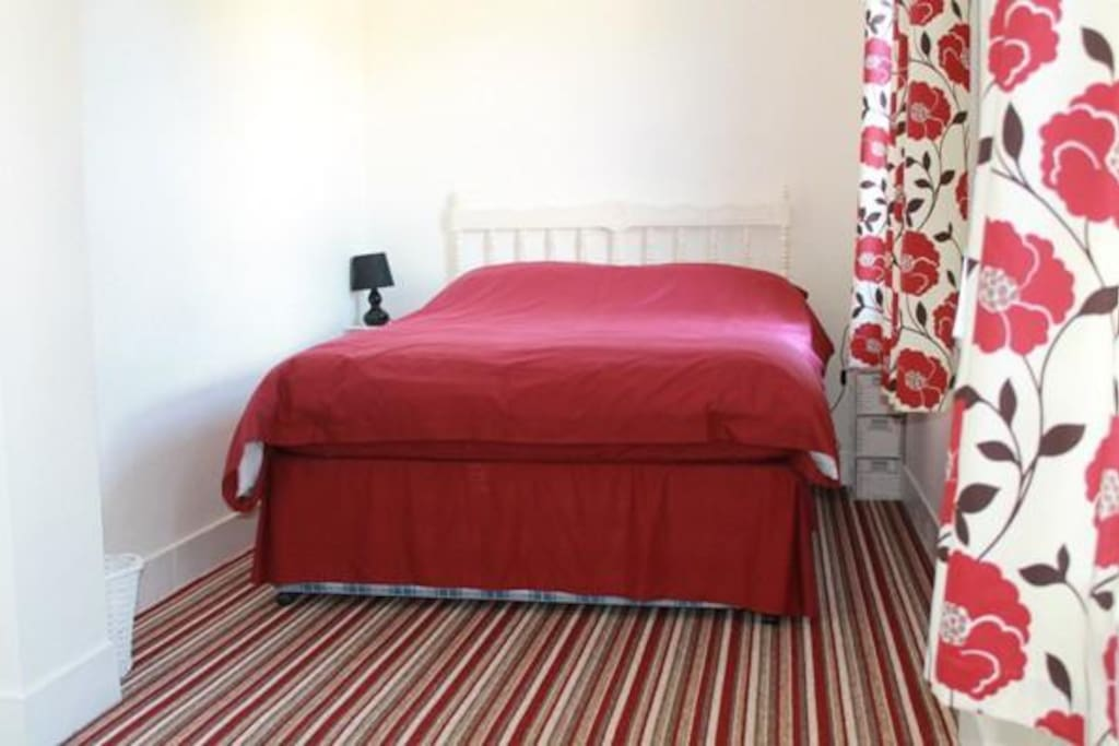 Bedroom with double bed and linen provided