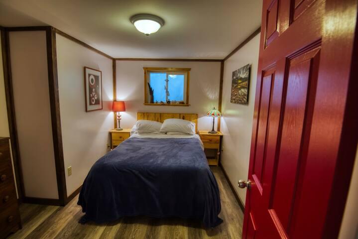 Bedroom 2 (red door), full/double bed.