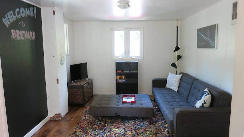 Living room with comfy sofa and smart TV