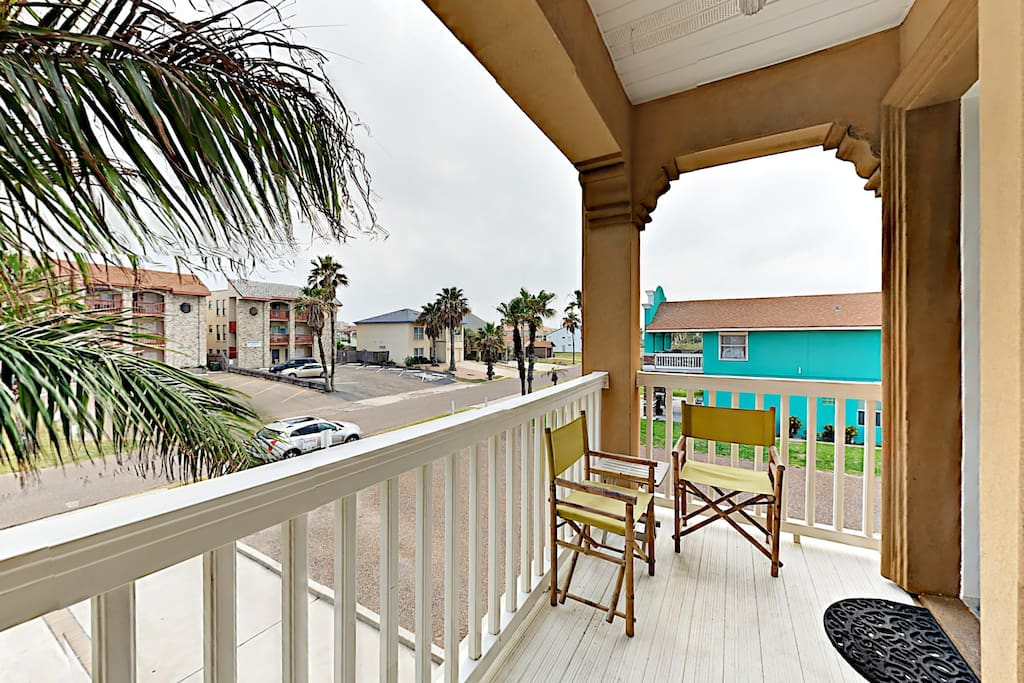 Step up to the condo's main entrance, where two patio chairs offer a lovely place to enjoy morning coffee.