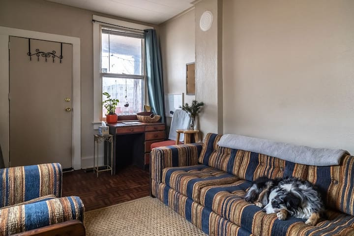 The front room is great for working at the small desk or for lounging. The large couch is comfortable for one person to sleep and there is extra bedding available. There is also an abundance of soft natural fiber blankets.