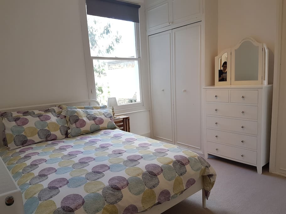 Bedroom downstairs with double bed and plenty of storage
