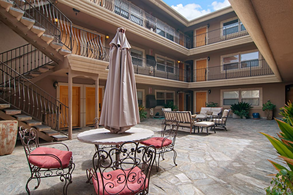 The courtyard features shaded outdoor seating