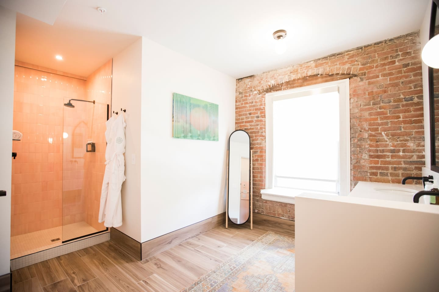 Beautiful bathroom with original brick walls and double sinks!