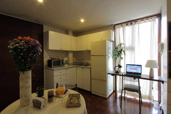 Desk and kitchen area