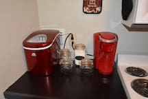 A Stocked Coffee Area with Ice Maker