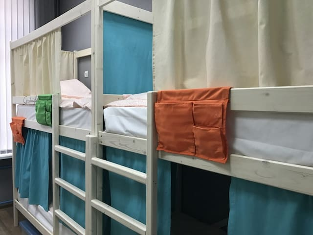Bed in 6-bed dormitory room for men and women. Rocket hostel
