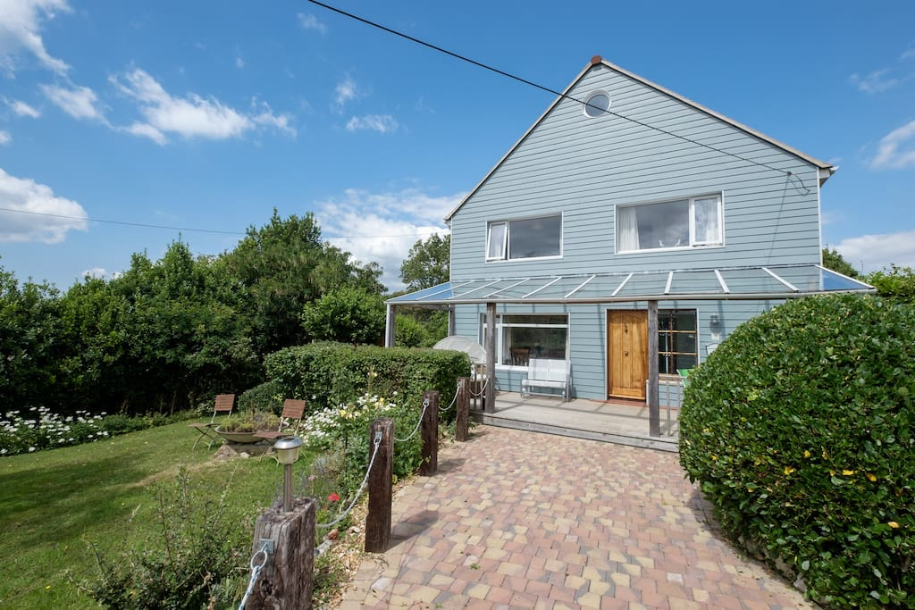 Large south facing veranda, drive way for 3 cars and half an acre of mature garden.
