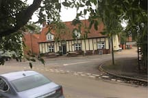 View from the windows across the High Street to the pub across the road