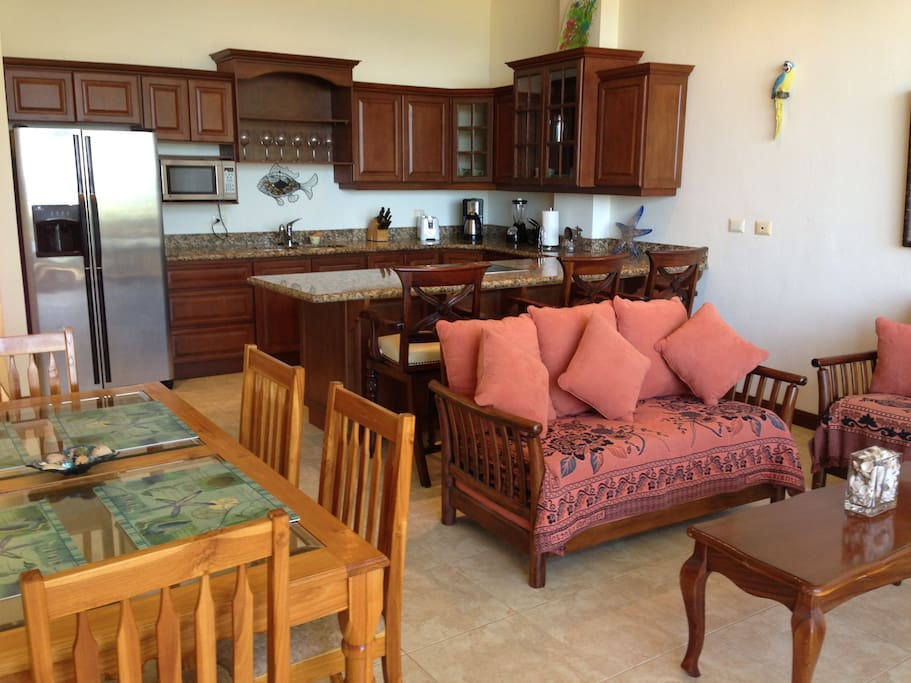 Dining room, living room and kitchen