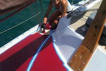 Justyna painting the deck. The coach-roof has been done also since then.