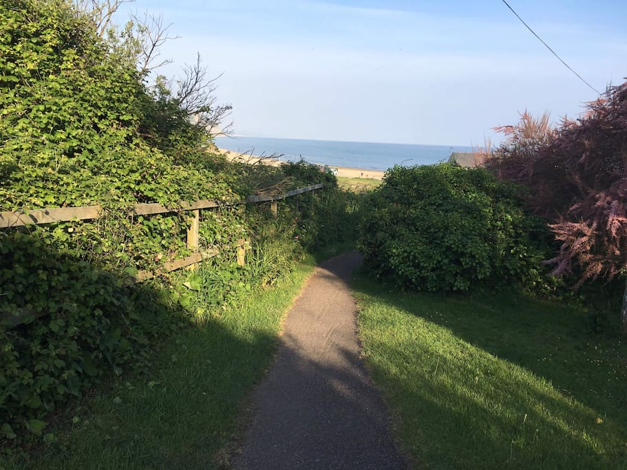 Short walk to beach from private gardens